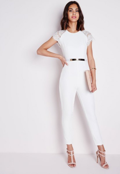 white jumpsuit with cap sleeves and light pink strappy sandals