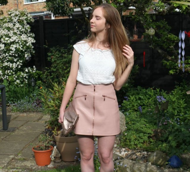 Crochet lace with white cap sleeves and pink leather mini skirt with a zipper in the front