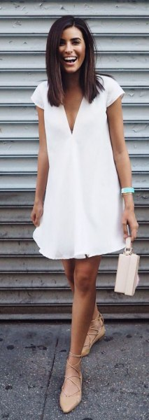 white swing dress with deep V-neckline and cap sleeves