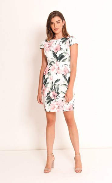 white mini tulip dress with cap sleeves and floral pattern