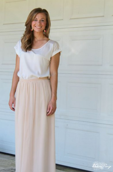 white silk top with cap sleeves and light pink, elastic, long tulle skirt