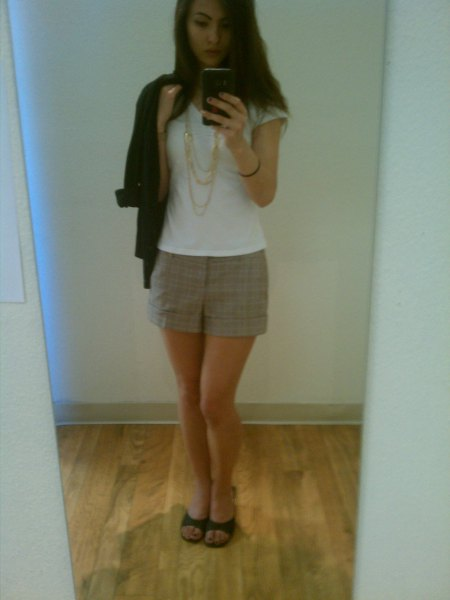 white t-shirt with cap sleeves, gray checked mini skirt and black sandals with kitten heel