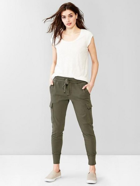white t-shirt with cap sleeves and green khaki joggers