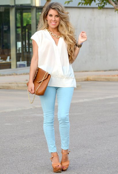 white wrap blouse with cap sleeves and colored skinny jeans