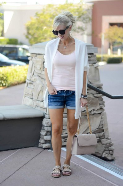 white cardigan sweater with figure-hugging tank top with scoop neckline and shorts