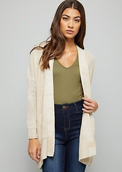 white cardigan with green V-neck t-shirt and high-waisted blue jeans