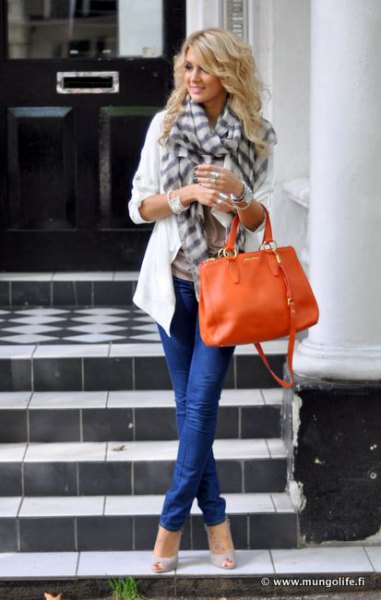 white casual blazer with gray checked scarf and orange leather handbag