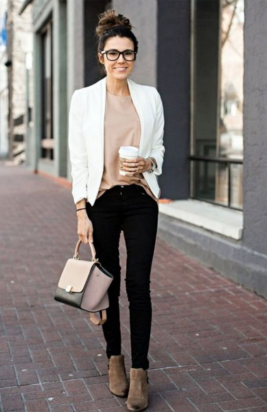 white, casual blazer with a pink top and black skinny jeans