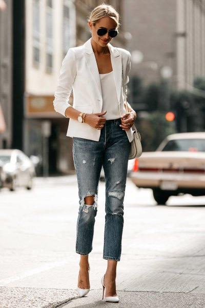white casual summer blazer with vest with scoop neckline and ripped jeans