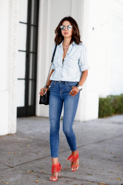 white chambray shirt with blue skinny jeans with a low waist
