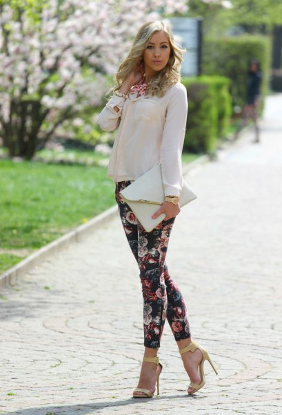 white chiffon blouse with black drainpipe trousers with a floral pattern