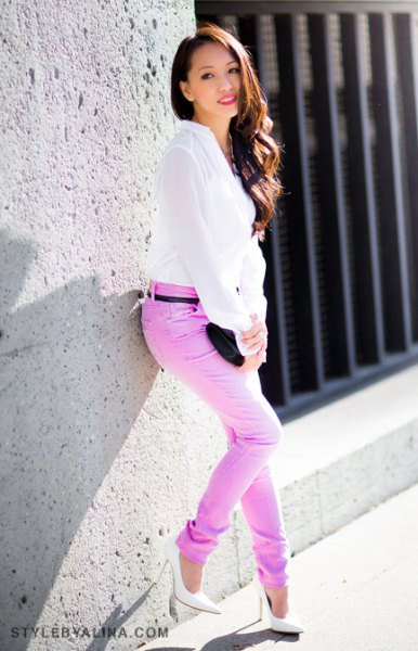 white chiffon blouse with colored slim fit jeans with belt