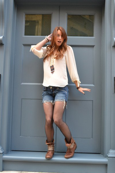 white chiffon blouse with denim mini-shorts and brown combat boots with rivets