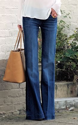 white chiffon blouse with flared jeans and brown leather handbag