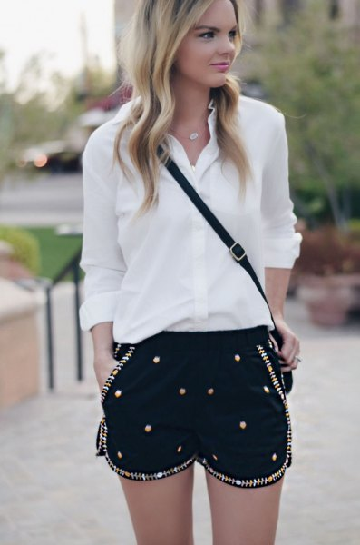 white chiffon shirt with button placket, black shorts embroidered with sequins