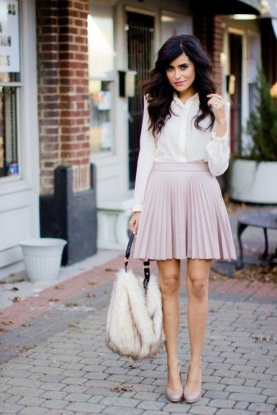 white chiffon shirt with buttons and light gray mini pleated skirt