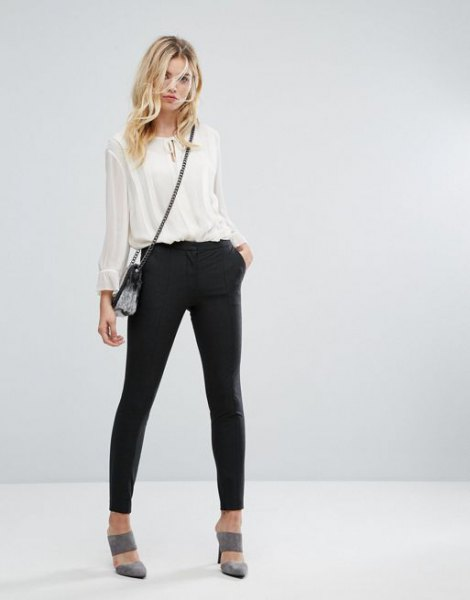 white, semi-transparent chiffon blouse with black joggers and gray heels