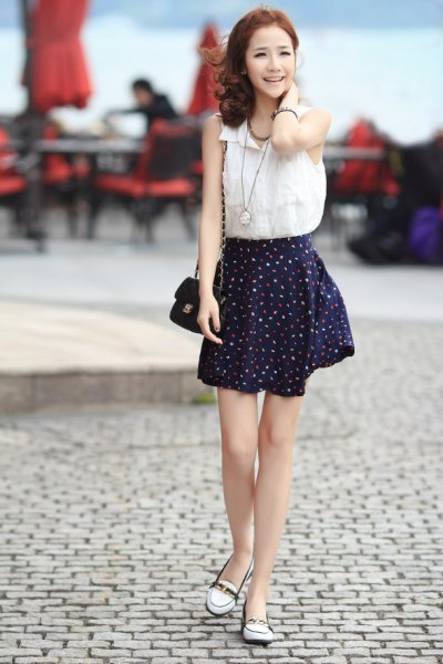 sleeveless shirt made of white chiffon black skater skirt made of chiffon