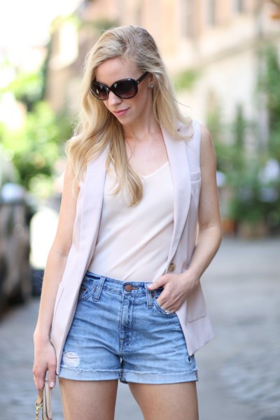 white chiffon tank top with light gray vest and denim shorts