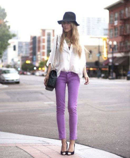 white chiffon blouse with wide sleeves, purple skinny jeans and floppy hat