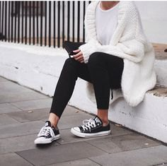 white, chunky knit sweater with black ankle jeans