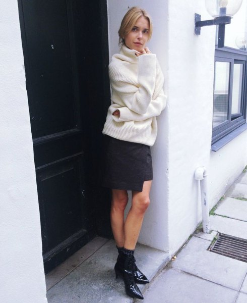 white, chunky sweater with a black wrap skirt and pointy toe boots with kitten heels