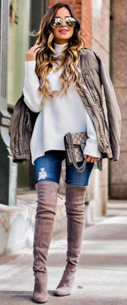 white, chunky sweater with light gray, oversized leather jacket and over-the-knee suede boots