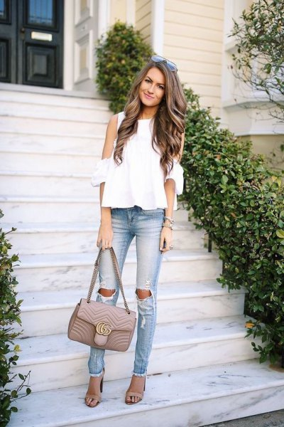 white chiffon blouse with cold shoulder and ripped slim fit jeans