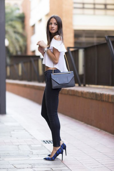 white, short cut blouse with cold shoulder and black skinny jeans