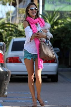 white t-shirt with cold shoulder and light pink scarf with denim shorts