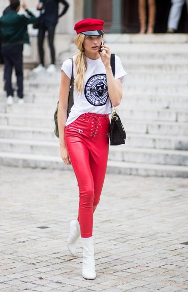 white cool graphic t-shirt with a red painter's hat and matching leather gaiters