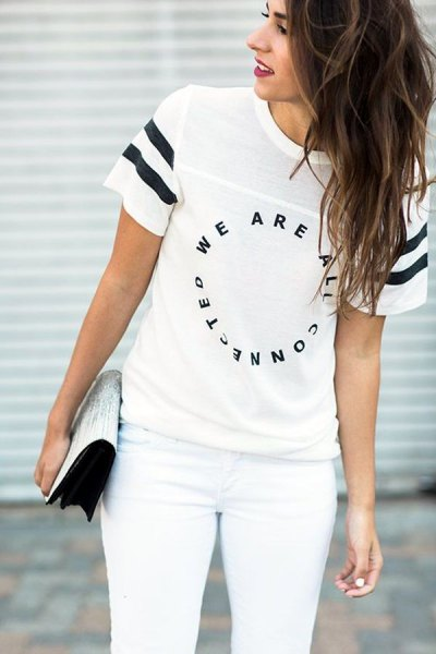white t-shirt with cool print, matching skinny jeans and clutch with sequins