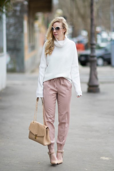 white sweater with a cowl neckline with blushing pants and heels