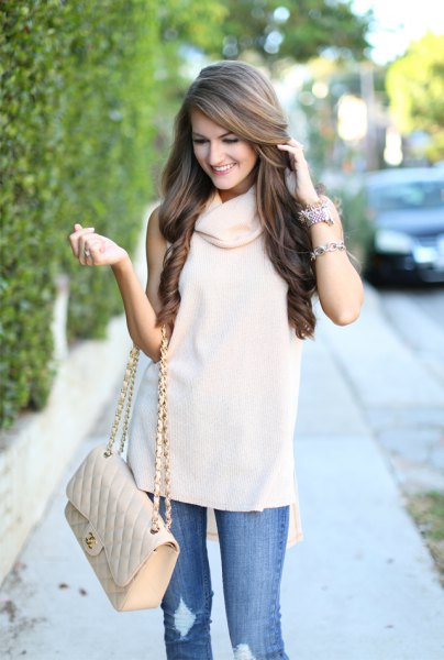 white sleeveless sweater with cowl neckline, ripped jeans