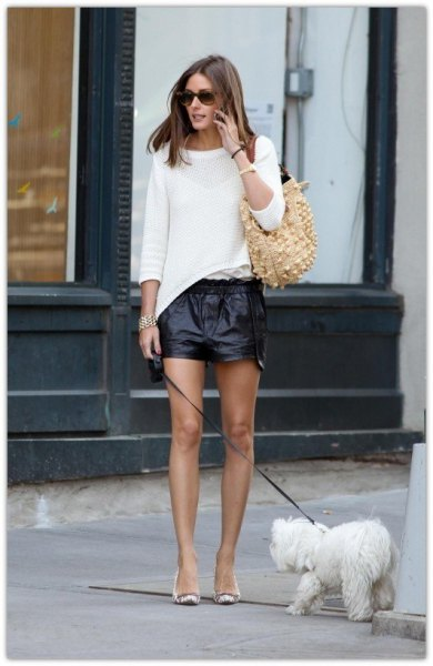 white cozy sweater with leather shorts and tassel heels
