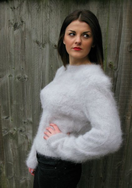 white mohair sweater with a round neckline, black skinny jeans