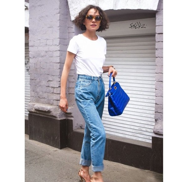 white crew-neck t-shirt and blue vintage high-waisted straight-leg jeans