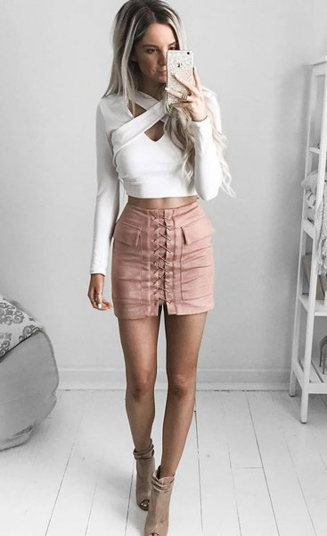 white criss cross front crop top pink lace-up mini skirt