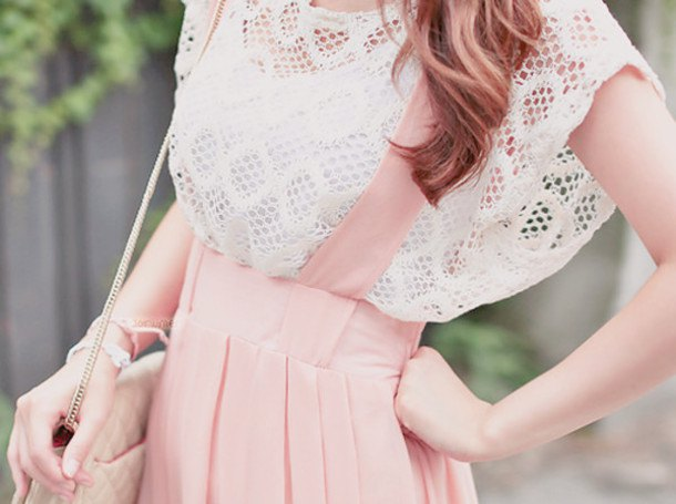 white crochet top with cap sleeves and light pink suspender dress