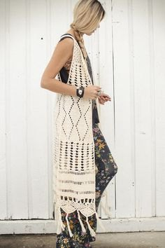 white crochet maxi knitted vest in maxi length with leggings with floral pattern