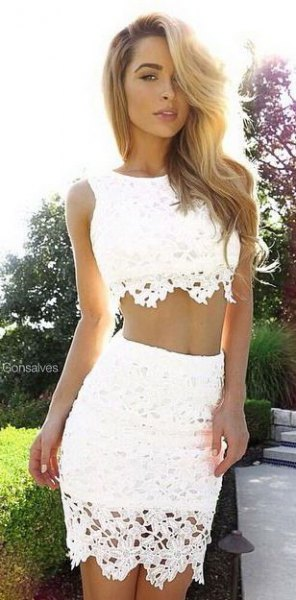 white crocheted two-piece, figure-hugging dress