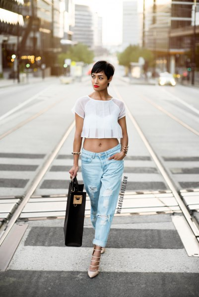 white, cropped chiffon top with light blue, torn baggy boyfriend jeans