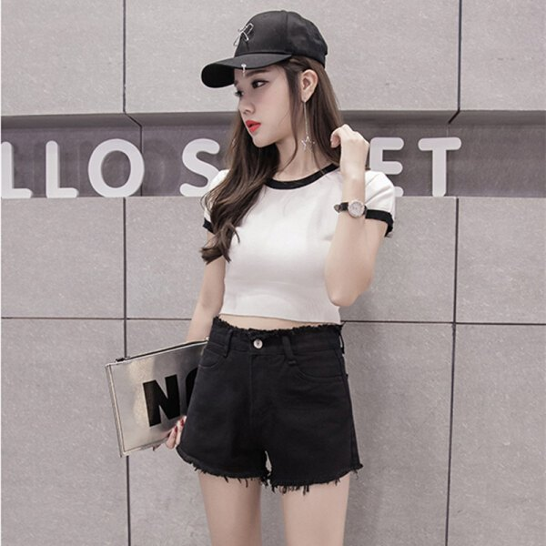 white, cropped, fitted t-shirt with black denim shorts