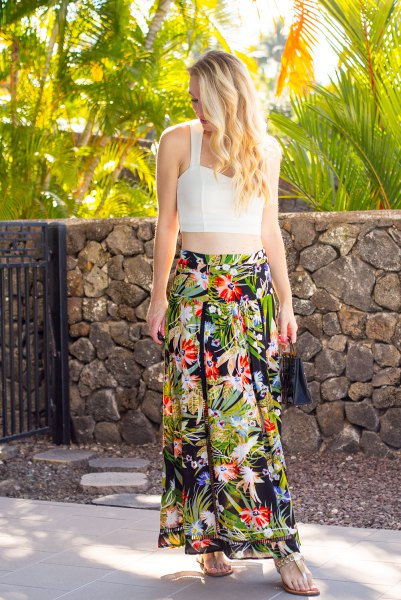 white, cropped, figure-hugging top with maxi chiffon skirt with a floral pattern