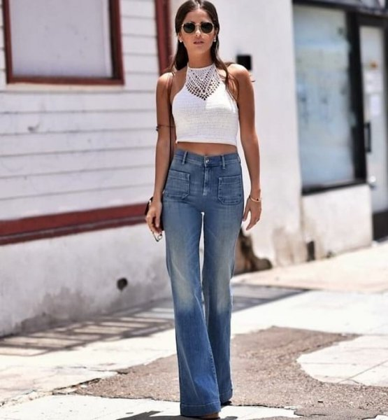 white, short halterneck top with blue jeans in boat cut