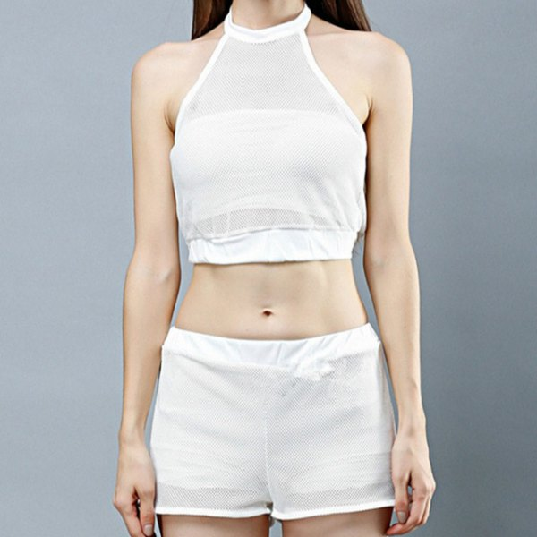 white, short halterneck top with mini mesh shorts