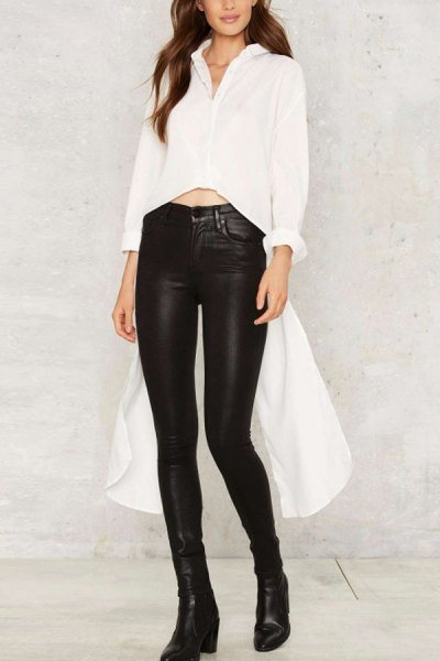 white, short cut, high, low blouse with black, high-waisted leather gaiters