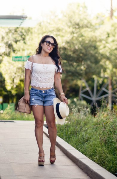 white top with shoulder-colored lace and blue denim shorts