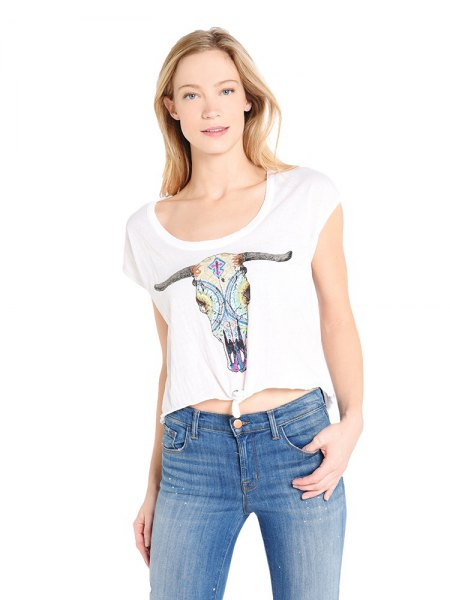 white t-shirt with cropped print and light blue jeans