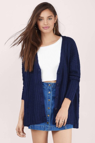 white, cropped sweater with ribbed dark blue cardigan and denim skirt